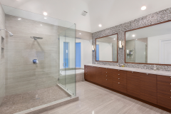 Large Vanity Mirror and Frameless Shower Enclosure