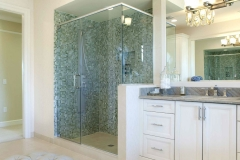 Large Vanity Mirror and Frameless Shower Doors